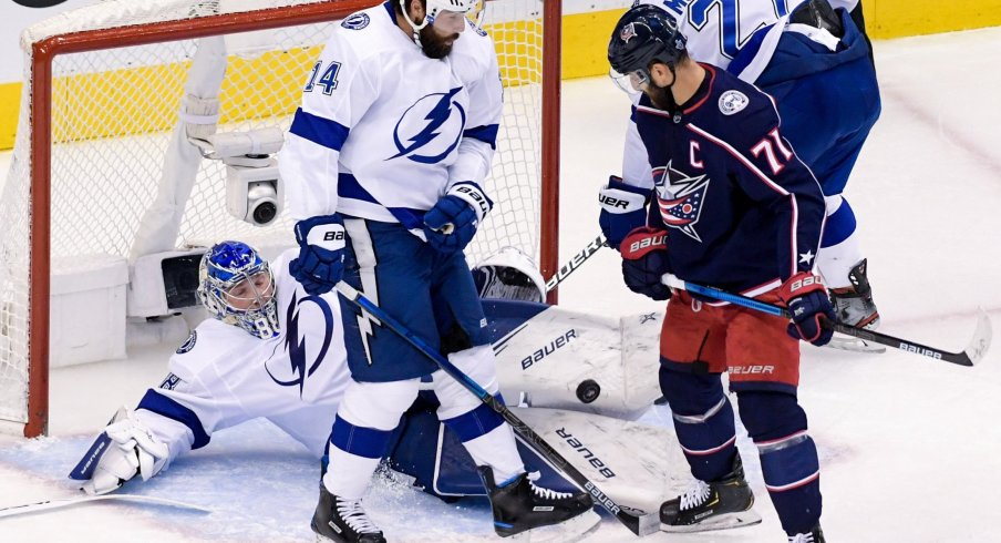 Tampa Bay Lightning goaltender Andrei Vasilevskiy (88) dives to make a save as Tampa Bay Lightning left wing Pat Maroon (14) plays against Columbus Blue Jackets left wing Nick Foligno (71) in the second period in game four of the first round of the 2020 Stanley Cup Playoffs at Scotiabank Arena.