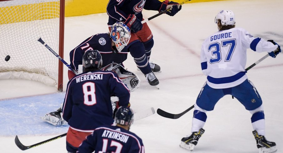 Yanni Gourde tips in the game-winning-goal for the Tampa Bay Lightning