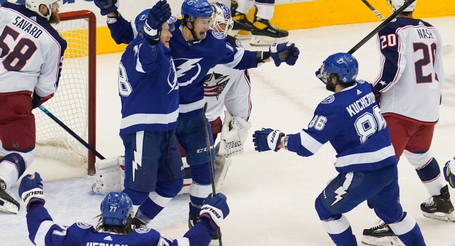 Aug 19, 2020; Toronto, Ontario, CAN; Tampa Bay Lightning forward Anthony Cirelli (71) celebrates scoring the tying goal with forward Ondrej Palat (18) and forward Nikita Kucherov (86) against Columbus Blue Jackets goaltender Joonas Korpisalo (70) to force overtime in game five of the first round of the 2020 Stanley Cup Playoffs at Scotiabank Arena.