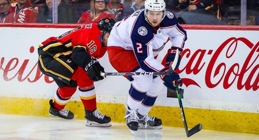 Andrew Peeke skates against the Calgary Flames
