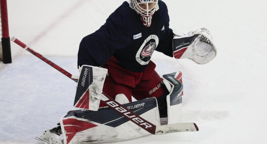 Elvis Merzlikins, getting some work in during practice Monday, excelled in goal after a rocky start filling in for the injured Joonas Korpisalo.