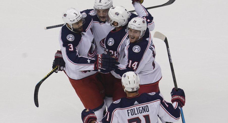 Aug 9, 2020; Toronto, Ontario, CAN; Columbus Blue Jackets forward Gustav Nyquist (14) and forward Boone Jenner (38)and defenseman Seth Jones (3) and forward Nick Foligno (71) celebrate a goal by defenseman Zach Werenski (8) against the Toronto Maple Leafs during the first period of game five of the Eastern Conference qualifications at Scotiabank Arena.
