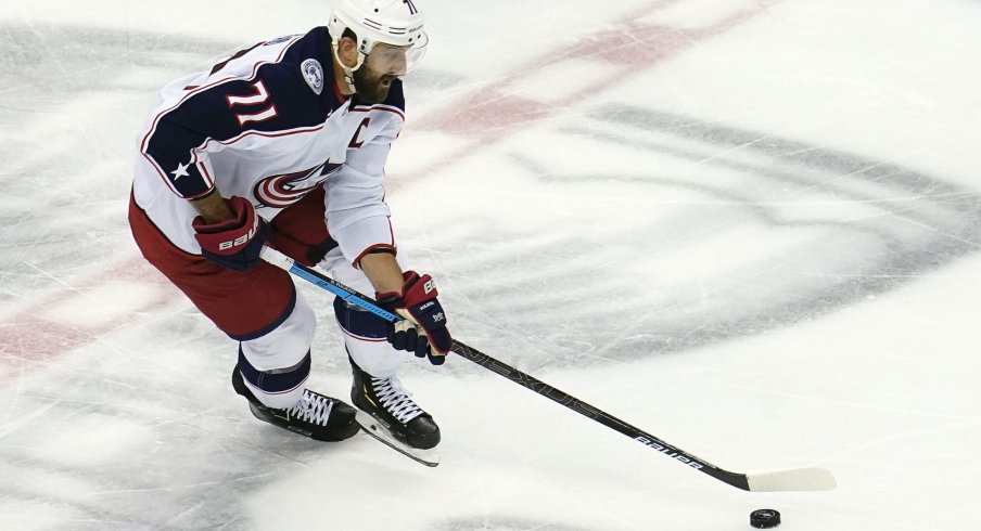 Aug 19, 2020; Toronto, Ontario, CAN; Columbus Blue Jackets left wing Nick Foligno (71) moves the puck against the Tampa Bay Lightning during the first period in game five of the first round of the 2020 Stanley Cup Playoffs at Scotiabank Arena.