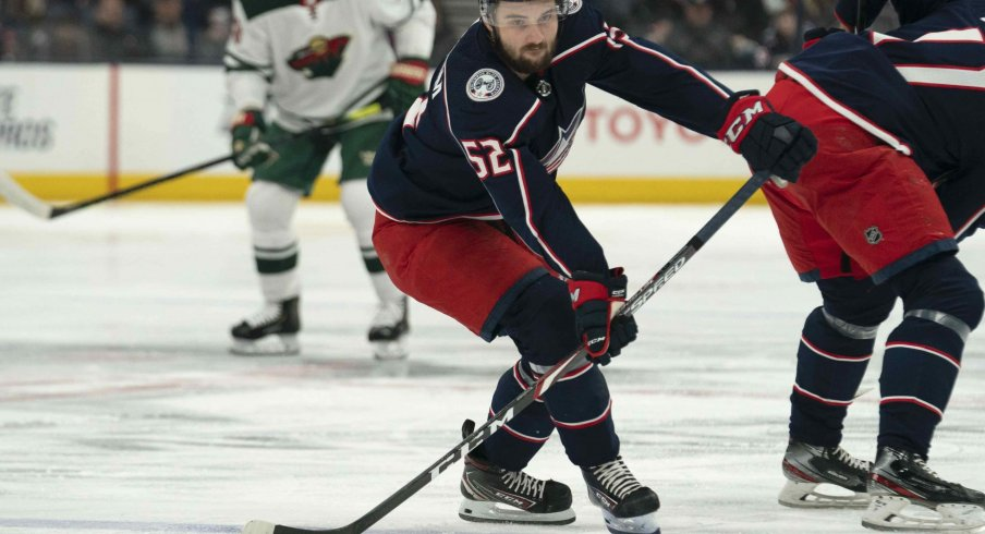 Feb 28, 2020; Columbus, Ohio, USA; Columbus Blue Jackets center Emil Bemstrom (52) looks to pass the puck during the game against the Minnesota Wild at Nationwide Arena.