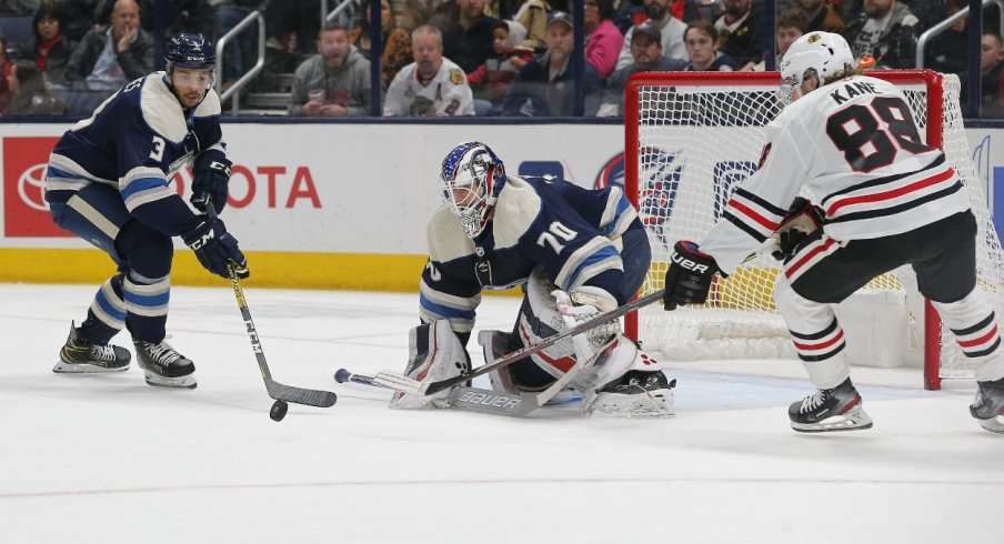 Columbus Blue Jackets defenseman Seth Jones (3) sticks the rebound away from Chicago Blackhawks right wing Patrick Kane (88) during the second period at Nationwide Arena