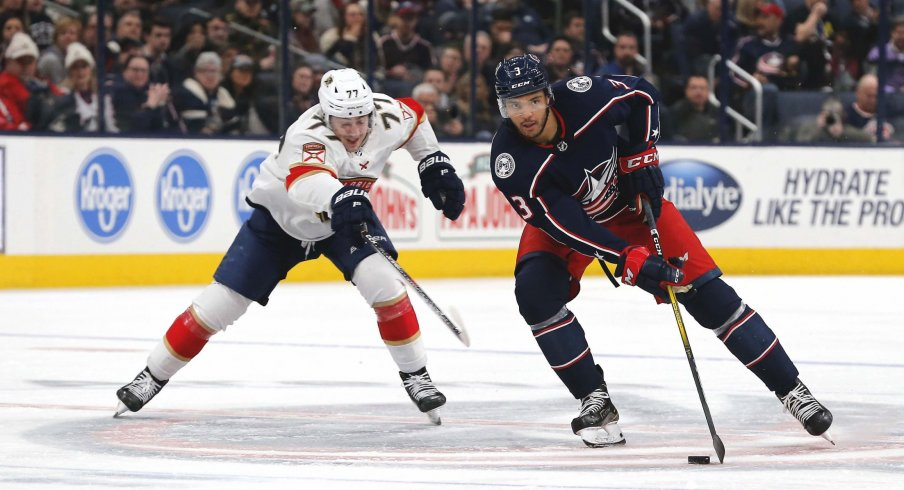 Feb 4, 2020; Columbus, Ohio, USA; Columbus Blue Jackets defenseman Seth Jones (3) stick handles as Florida Panthers left wing Frank Vatrano (77) trails the play during the second period at Nationwide Arena.