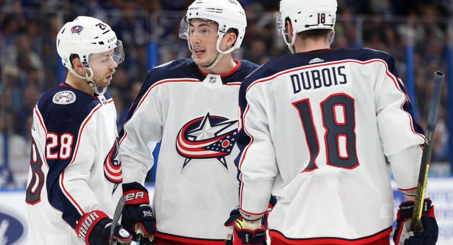 Columbus Blue Jackets forwards Oliver Bjorkstrand and Pierre-Luc Dubois celebrate a goal scored by Zach Werenski against the Tampa Bay Lightning.