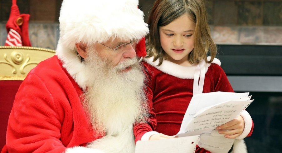 Lacie Shuff, 8, of Altoona reviews her wish list with Santa during Breakfast with Santa on Saturday, Dec. 1, 2018 at the Youth Center in Doanes Park in Pleasant Hill.