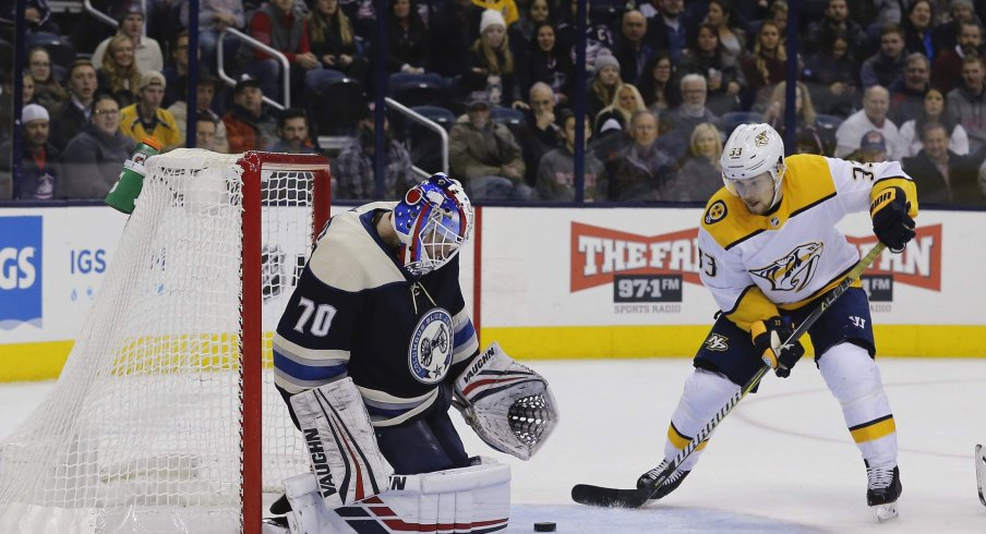 Jan 10, 2019; Columbus, OH, USA; Columbus Blue Jackets goalie Joonas Korpisalo (70) makes a save as Nashville Predators right wing Viktor Arvidsson (33) looks for the rebound during the third period at Nationwide Arena.