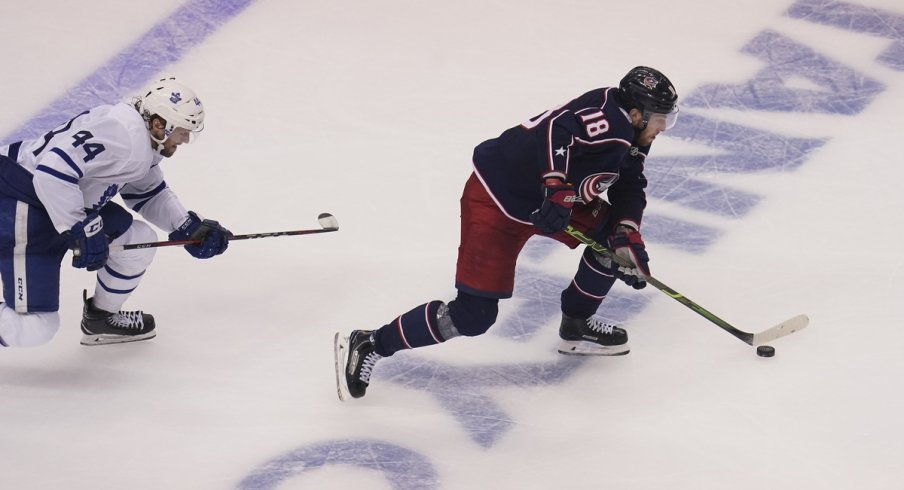 Columbus Blue Jackets forward Pierre-Luc Dubois (18) gets past Toronto Maple Leafs defenseman Morgan Rielly (44) to score the winning goal during overtime of Eastern Conference qualifications at Scotiabank Arena
