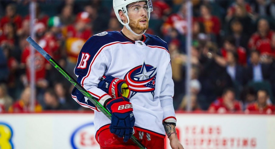 Pierre-Luc Dubois looks to the scoreboard against the Calgary Flames
