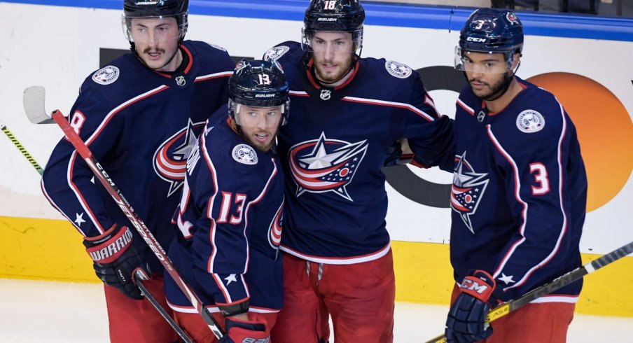 Aug 17, 2020; Toronto, Ontario, CAN; Columbus Blue Jackets right wing Cam Atkinson (13) celebrates with teammates , defenseman Zach Werenski (8), center Pierre-Luc Dubois (18), and defenseman Seth Jones (3) after scoring a goal in the second period in game four of the first round of the 2020 Stanley Cup Playoffs at Scotiabank Arena.