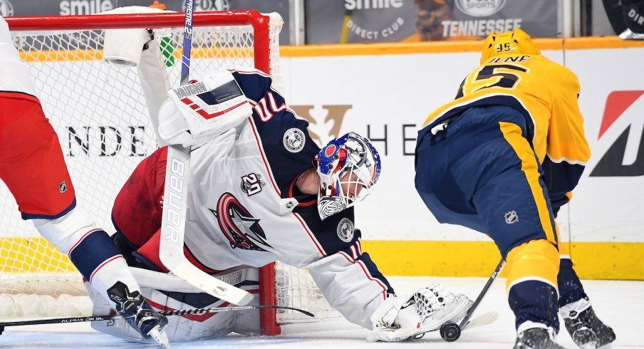 Columbus Blue Jackets goaltender Joonas Korpisalo (70) is unable to take the puck from Nashville Predators center Matt Duchene (95) during the first period at Bridgestone Arena.