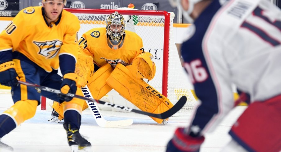 Nashville Predators goaltender Juuse Saros (74) waits for a shot from Max Domi (16) during the second period at Bridgestone Arena.