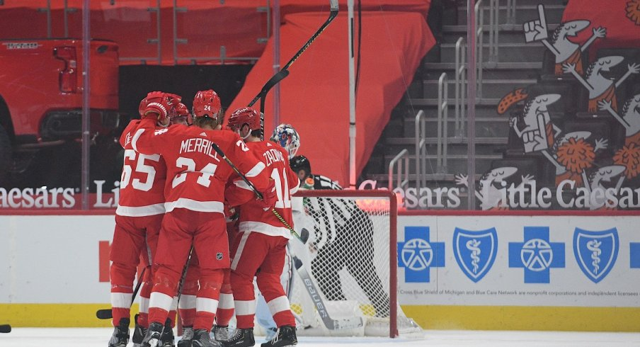 Bobby Ryan celebrates with teammates after scoring a goal against the Columbus Blue Jackets during the first period at Little Caesars Arena