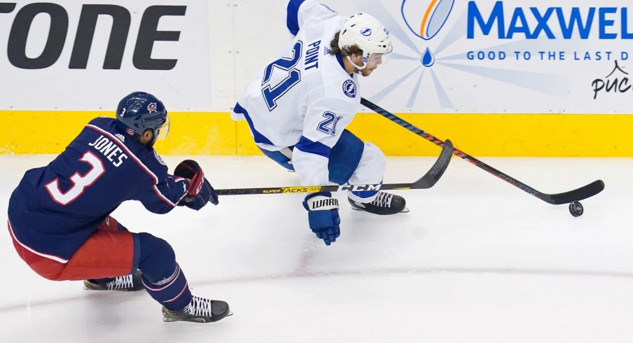 Aug 15, 2020; Toronto, Ontario, CAN; Tampa Bay Lightning center Brayden Point (21) skates with the puck as Columbus Blue Jackets defenseman Seth Jones (3) gives chase during the first period of game three of the first round of the 2020 Stanley Cup Playoffs at Scotiabank Arena.