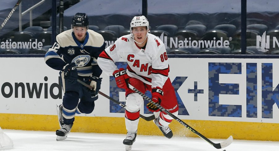 Carolina Hurricanes winger Teuvo Teravainen carries the puck as Columbus Blue Jackets center Alexandre Texier trails the play during the first period at Nationwide Arena.
