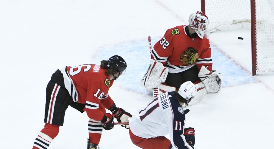 Columbus Blue Jackets center Kevin Stenlund (11) scores a goal on Chicago Blackhawks goaltender Kevin Lankinen (32) during the third period at United Center.