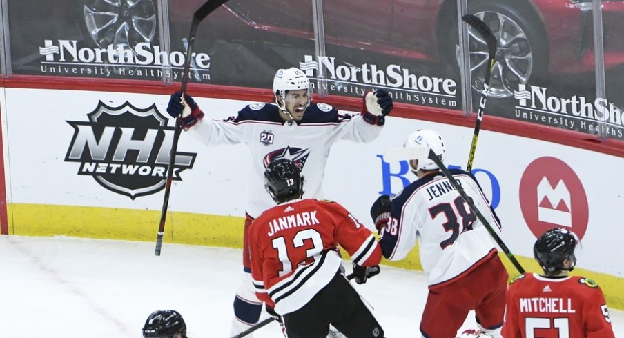 Columbus Blue Jackets defenseman Michael Del Zotto (15) celebrates his goal against the Chicago Blackhawks during the third period at United Center.