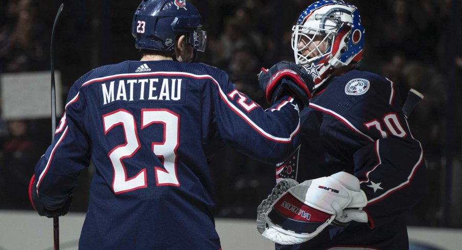 Mar 1, 2020; Columbus, Ohio, USA; Columbus Blue Jackets goaltender Joonas Korpisalo (70) is congratulated by center Stefan Matteau (23) after their win against the Vancouver Canucks at Nationwide Arena.