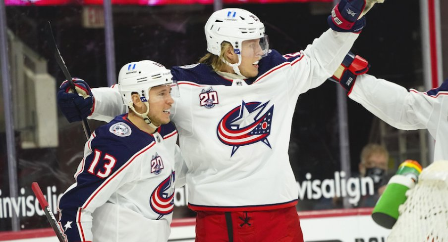 Columbus Blue Jackets right wing Cam Atkinson (13) is congratulated by right wing Patrik Laine (29) after his goal against the Carolina Hurricanes the first period at PNC Arena.