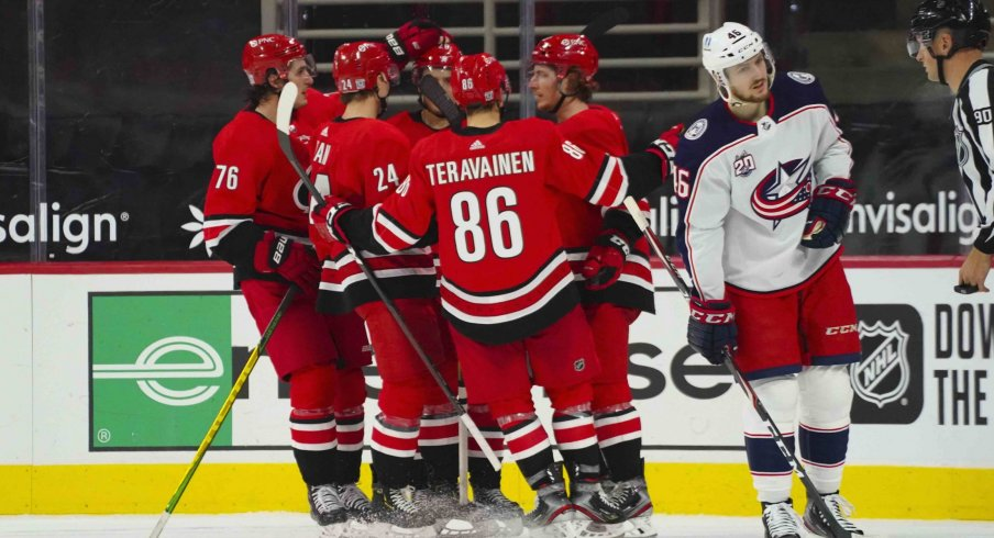 Feb 15, 2021; Raleigh, North Carolina, USA; Carolina Hurricanes left wing Brock McGinn (23) is congratulated by left wing Teuvo Teravainen (86) defenseman Jake Bean (24) right wing Sebastian Aho (20) and defenseman Brady Skjei (76) after his goal against the Columbus Blue Jackets during the third period at PNC Arena.
