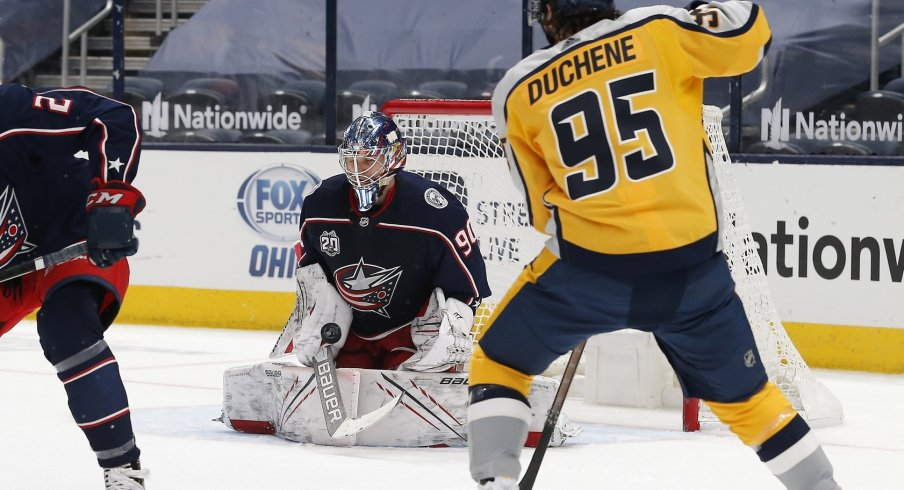 Columbus Blue Jackets goalie Elvis Merzlikins makes a stick save during the second period against the Nashville Predators at Nationwide Arena.