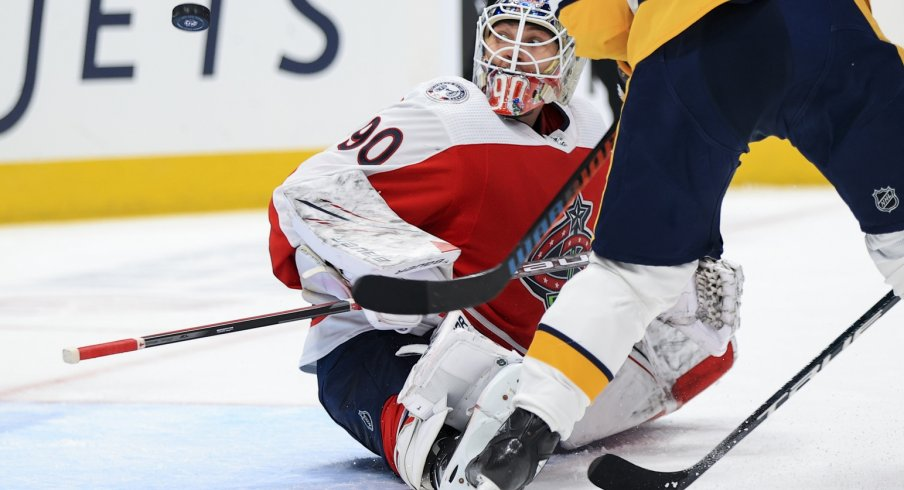 Columbus Blue Jackets goaltender Elvis Merzlikins follows the puck in the air in the game against the Nashville Predators in the second period at Nationwide Arena.
