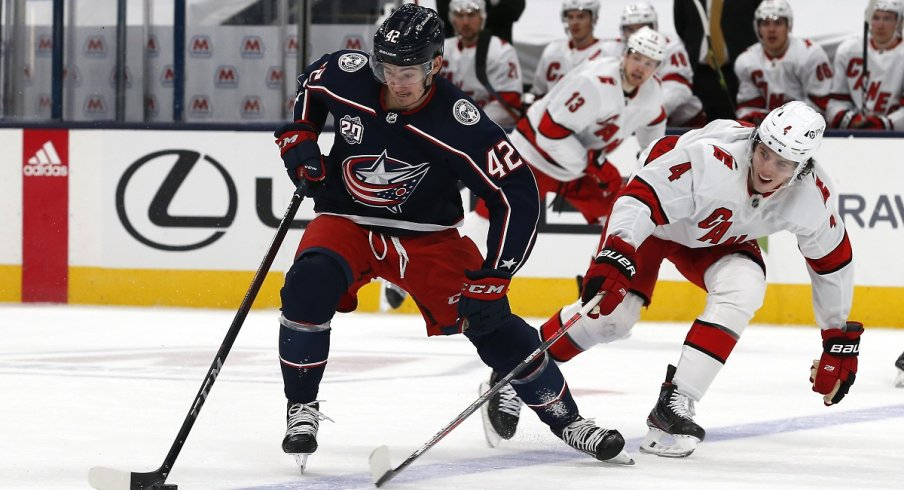Alexandre Texier protects the puck from the Carolina Hurricanes