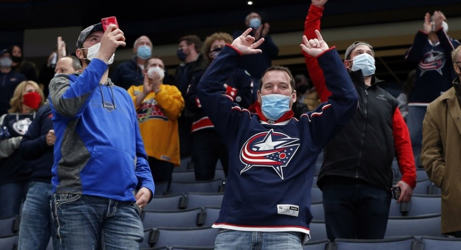 olumbus Blue Jackets fans celebrate a goal against the Detroit Red Wings during the second period at Nationwide Arena.