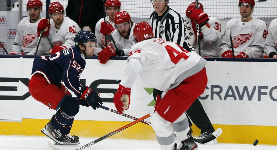 Columbus Blue Jackets center Emil Bemstrom (52) moves the puck past Detroit Red Wings center Darren Helm (43) during the first period at Nationwide Arena.