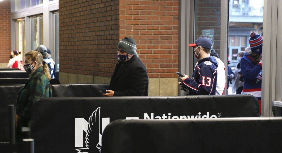 Mar 2, 2021; Columbus, Ohio, USA; Fans file into Nationwide Arena, for the first time this season, for the game between the Columbus Blue Jackets and Detroit Red Wings.