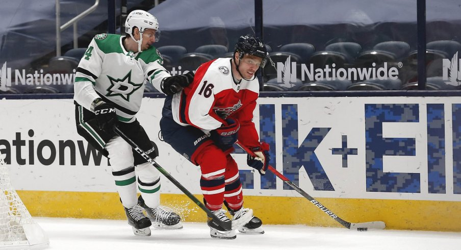 Feb 2, 2021; Columbus, Ohio, USA; Columbus Blue Jackets center Max Domi (16) looks to pass as Dallas Stars defenseman Miro Heiskanen (4) defends during the third period at Nationwide Arena.