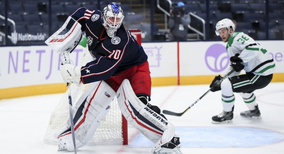 Columbus Blue Jackets goaltender Joonas Korpisalo (70) controls the puck against the Dallas Stars in the second period at Nationwide Arena.