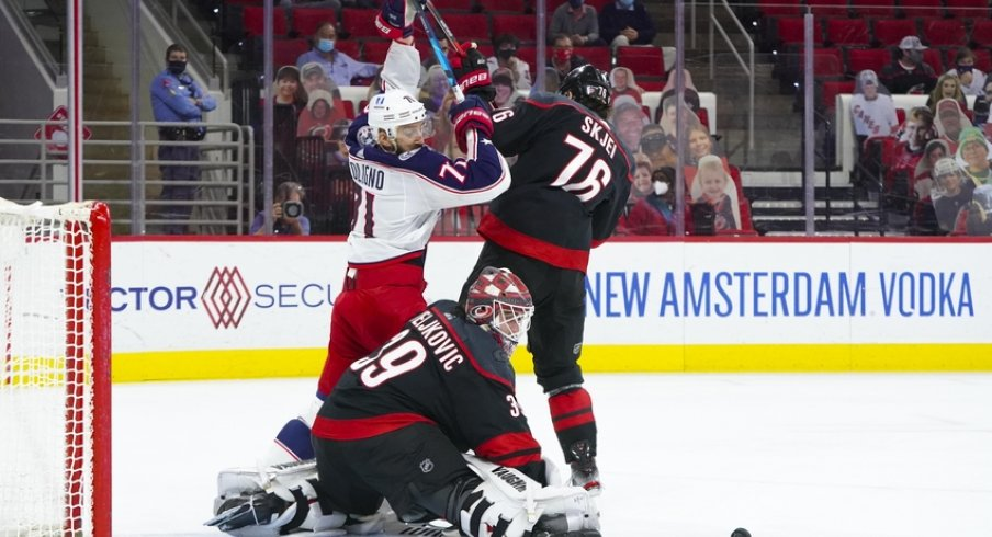 Carolina Hurricanes goaltender Alex Nedeljkovic (39) with defenseman Brady Skjei (76) turns the shot away from Columbus Blue Jackets left wing Nick Foligno (71) during the first period at PNC Arena.