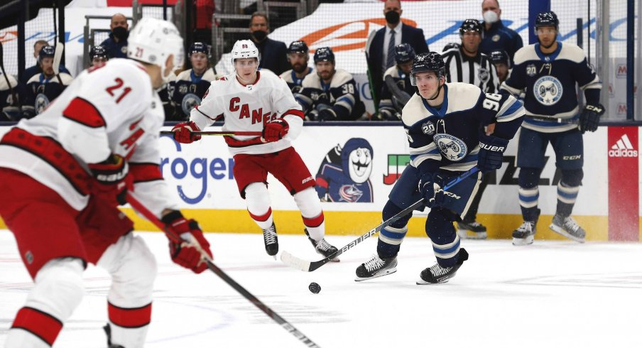Mar 25, 2021; Columbus, Ohio, USA; Columbus Blue Jackets center Jack Roslovic (96) carries the puck as Carolina Hurricanes center Martin Necas (88) trails the play during the first period at Nationwide Arena.