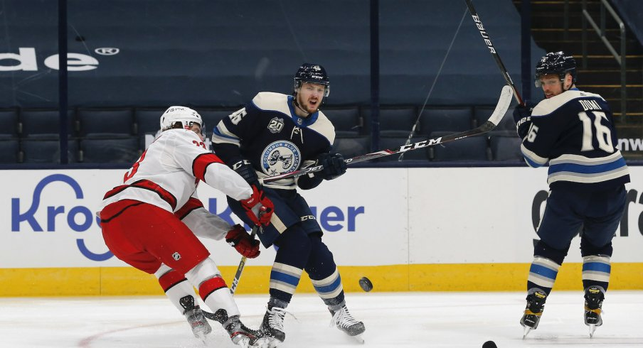 Columbus Blue Jackets forward Max Domi fights for the puck against the Carolina Hurricanes at Nationwide Arena.