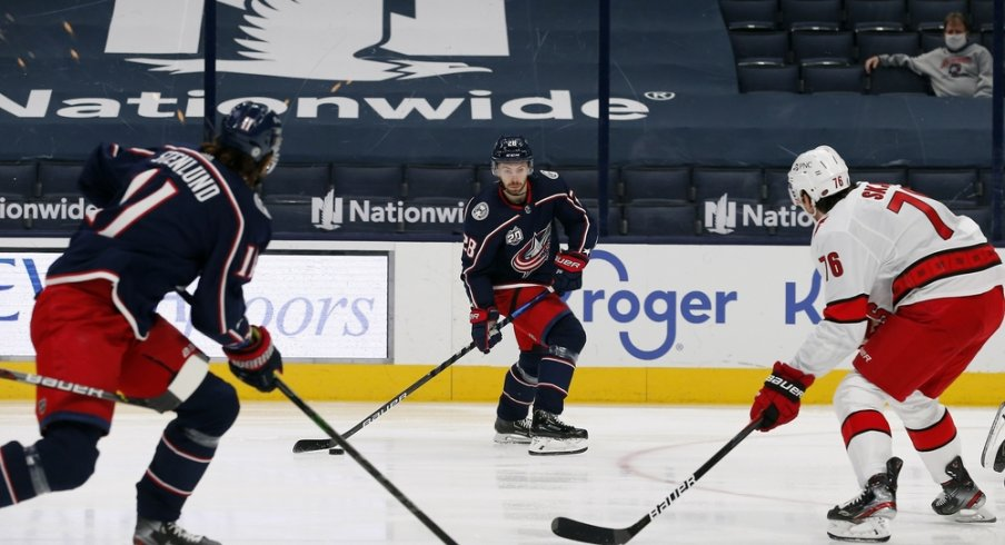 Columbus Blue Jackets right wing Oliver Bjorkstrand (28) looks to pass as Carolina Hurricanes defenseman Brady Skjei (76) defends during the first period at Nationwide Arena.