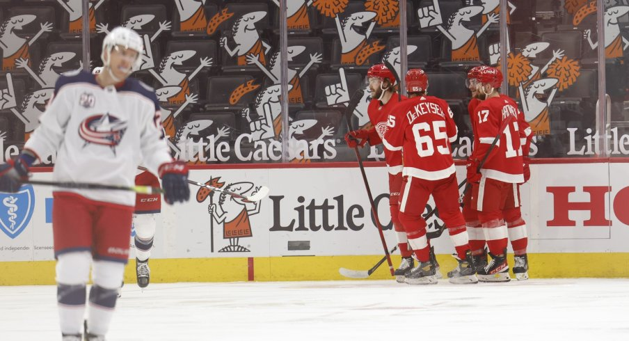 Detroit Red Wings center Michael Rasmussen (27) is congratulated by teammates after scoring in the third period against the Columbus Blue Jackets at Little Caesars Arena.