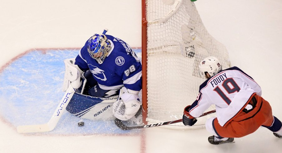 Aug 13, 2020; Toronto, Ontario, CAN; Tampa Bay Lightning goaltender Andrei Vasilevskiy (88) blocks the shot of Columbus Blue Jackets center Liam Foudy (19) during the third period in game two of the first round of the 2020 Stanley Cup Playoffs at Scotiabank Arena.