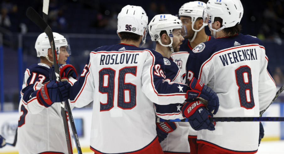 Columbus Blue Jackets right wing Oliver Bjorkstrand (28) is congratulated by teammates after scoring a goal against the Tampa Bay Lightning during the second period at Amalie Arena.