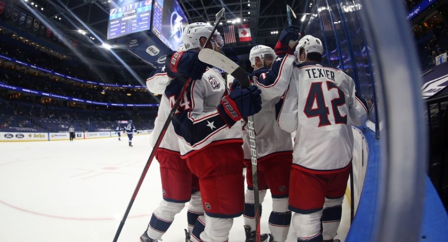 Columbus Blue Jackets defenseman David Savard (58) is congratulated after scoring a goal against the Tampa Bay Lightning during the second period at Amalie Arena.