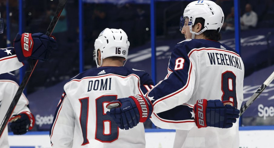 Columbus Blue Jackets defenseman Zach Werenski (8) is congratulated as he scores a goal against the Tampa Bay Lightning during the second period at Amalie Arena.