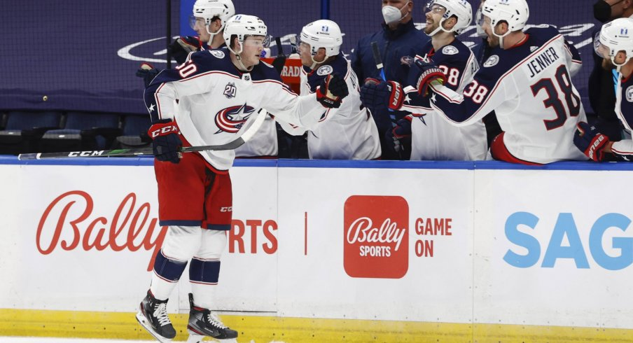 Apr 1, 2021; Tampa, Florida, USA; Columbus Blue Jackets left wing Eric Robinson (50) is congratulated as he scores a goal against the Tampa Bay Lightning during the third period at Amalie Arena.