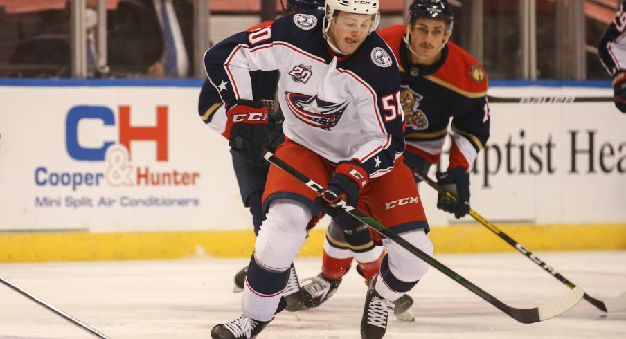 Columbus Blue Jackets left wing Eric Robinson (50) skates with the puck against the Florida Panthers during the first period at BB&T Center.