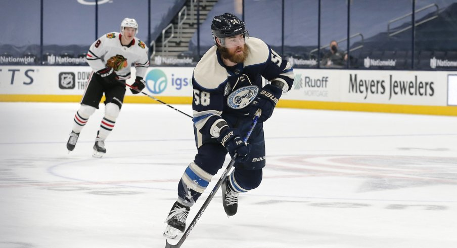 Columbus Blue Jackets defenseman David Savard (58) carries the puck against the Chicago Blackhawks during the first period at Nationwide Arena.
