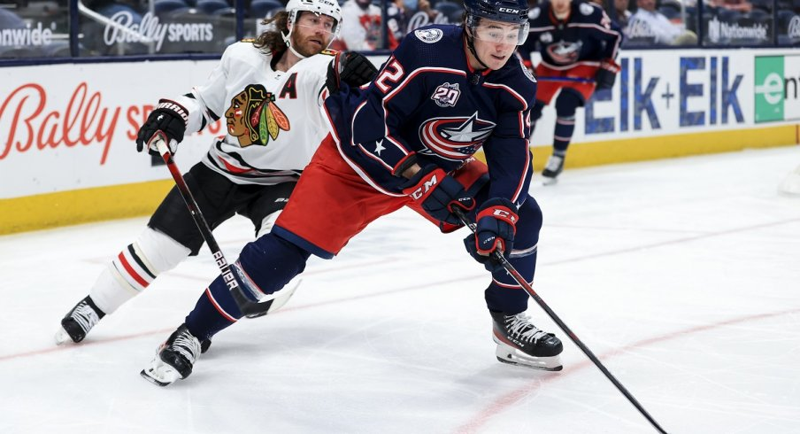 Alexandre Texier controls the puck against Duncan Keith