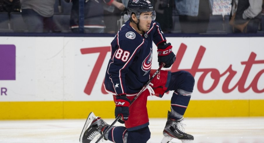 Columbus Blue Jackets right wing Kole Sherwood (88) stretches in warm-ups prior to a game against the Calgary Flames at Nationwide Arena.