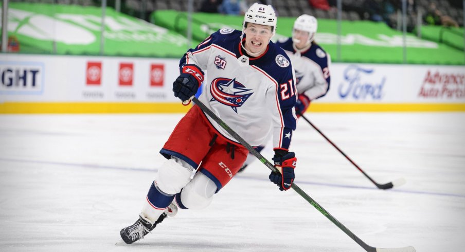 Apr 15, 2021; Dallas, Texas, USA; Columbus Blue Jackets rookie center Josh Dunne (21) skates in his first NHL game during the second period against the Dallas Stars at the American Airlines Center.