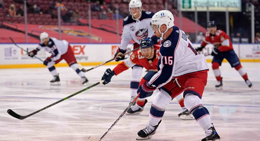 Apr 4, 2021; Sunrise, Florida, USA; Columbus Blue Jackets center Max Domi (16) controls the puck against the Florida Panthers during the first period at BB&T Center.